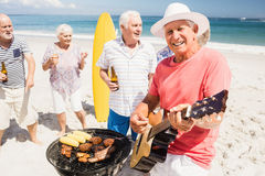 Senior friends having a barbecue Stock Images