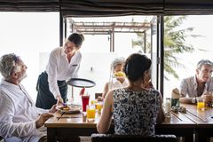 Senior friends having breakfast at a hotel stock images