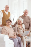Senior friends and laptop Stock Images