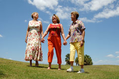 Senior friends laughing outdoors Royalty Free Stock Photography