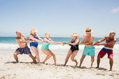 Senior friends playing tug of war Royalty Free Stock Photography