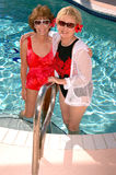 Senior friends by the pool Royalty Free Stock Photo