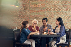 Senior friends in restaurant Stock Photography