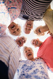 Senior friends standing in circle Royalty Free Stock Image