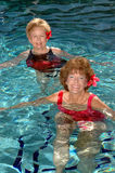 Senior friends swimming Royalty Free Stock Photography