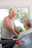 Senior friends working out in fitness club Royalty Free Stock Images