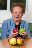 Senior with fruit for vitamins Stock Photo