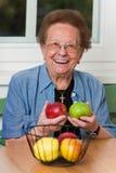 Senior with fruit for vitamins stock photo
