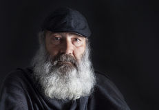 Senior with full white beard. On black stock images