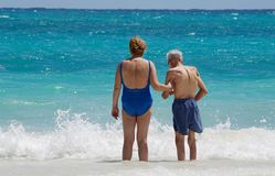 Senior fun. Old couple standing by the caribbean ocan Stock Image