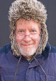 Senior in fur and leather hat. Stock Photos
