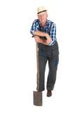 Senior gardener. Standing in studio isolated over white background royalty free stock photo