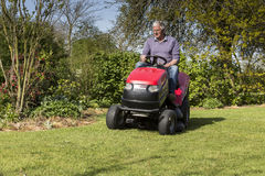 Senior gardener cut grass royalty free stock photography