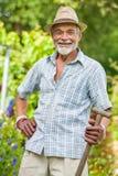 Senior gardener with a spade Stock Photos