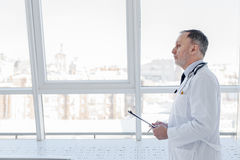 Senior general practitioner working at clinic Stock Photo