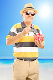 Senior gentelman holding a bowl of watermelon slices Royalty Free Stock Image