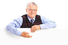 Senior gentleman behind a white billboard Royalty Free Stock Photography