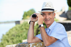 Senior gentleman with binoculars Royalty Free Stock Image