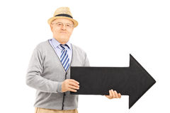 Senior gentleman holding big black arrow pointing right Stock Photography