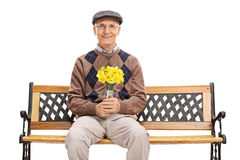 Senior gentleman holding a bunch of flowers Stock Photo