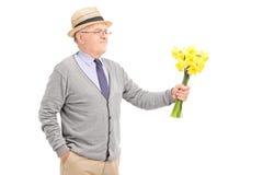 Senior gentleman holding a bunch of tulips Stock Image
