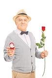 Senior gentleman holding an engagement ring Stock Image