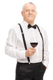 Senior gentleman holding a glass of red wine Royalty Free Stock Image