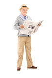 Senior gentleman holding a newspaper Royalty Free Stock Photos
