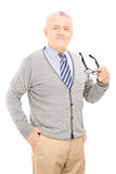 Senior gentleman holding a pair of glasses Royalty Free Stock Photo