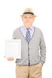 Senior gentleman holding a picture frame Stock Photo
