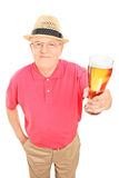 Senior gentleman holding a pint of beer Royalty Free Stock Images