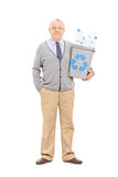 Senior gentleman holding a recycle bin Stock Image
