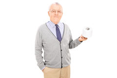 Senior gentleman holding a toilet paper roll Stock Photo