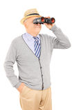 Senior gentleman looking through binoculars Stock Photography