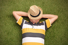 Senior gentleman lying in a field on green grass Stock Photos