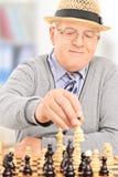 Senior gentleman playing chess at home Stock Photos