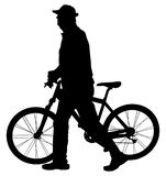 Senior gentleman pushing a bicycle in a park, vector silhouette. Old man walking and resting of bicycle riding. Senior gentleman pushing a bicycle in a park Royalty Free Stock Photography