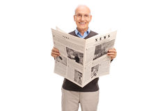 Senior gentleman reading a newspaper Royalty Free Stock Image