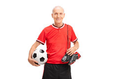 Senior gentleman in a red jersey holding a football Royalty Free Stock Images