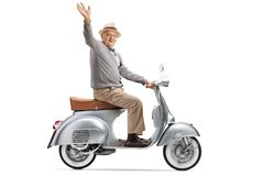 Senior gentleman riding a vintage scooter and waving at the came royalty free stock image