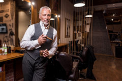 Senior gentleman standing with glass and cigar Royalty Free Stock Images