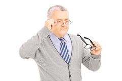 Senior gentleman trying on new pair of glasses Royalty Free Stock Images