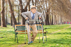Senior gentleman with walker in the park Royalty Free Stock Photos