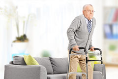 Senior gentleman walking with walker Stock Image