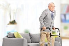Senior gentleman walking with walker stock image
