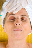 Senior Getting Botox Injection In Eyebrow Royalty Free Stock Photo