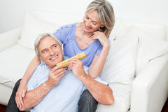 Senior giving woman valentines day Stock Images