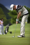 Senior Golf Player Putting At Hole. Royalty Free Stock Photo