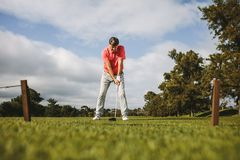 Senior golf player about to take the shot royalty free stock photos