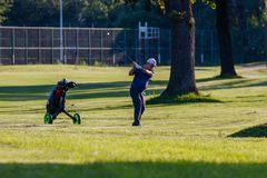 Belgrade, Serbia- June 1, 2019: Senior golfer preparing to hit the ball on the local golf court royalty free stock image